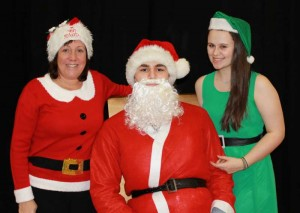 staff member Julie Harrison with Santa aka Arian Ejraee and student Sarah Carden